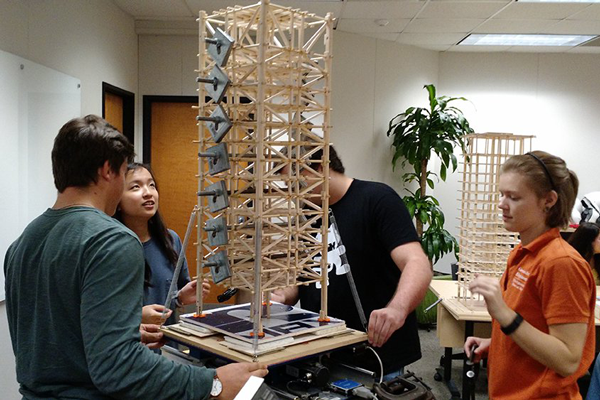 Students working on a tower